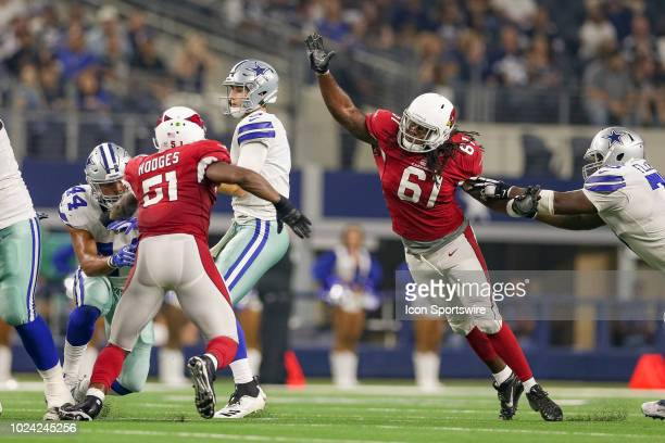 Arizona Cardinals defensive end Cap Capi strips the ball loose from Dallas Cowboys quarterback Mike White during the preseason football game between...