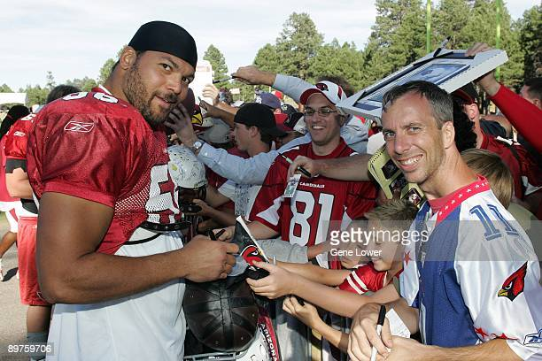 Arizona Cardinals defensive end Chike Okeafor signs autographs during training camp on August 7 2009 in Flagstaff Arizona