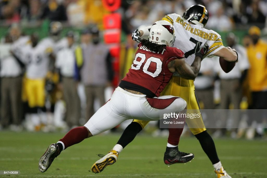 Arizona Cardinals defensive lineman Darnell Dockett #90 gets one of his three sacks during a game against the Pittsburgh Steelers during Super Bowl XLIII on February 1, 2009 at Raymond James Stadium in Tampa, Florida. The Steelers won the game 27-23.