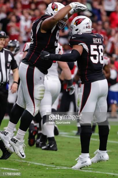Arizona Cardinals defensive tackle Corey Peters and Arizona Cardinals middle linebacker Jordan Hicks celebrate a sack during the NFL football game...