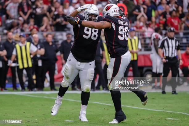 Arizona Cardinals defensive tackle Corey Peters and Arizona Cardinals defensive end Jonathan Bullard celebrate a big play during the NFL football...