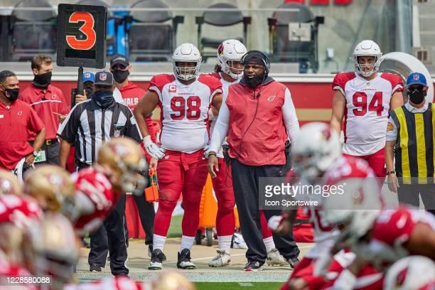 Arizona Cardinals defensive tackle Corey Peters and Arizona Cardinals defensve line coach Brentson Buckner look on during the NFL game between the...