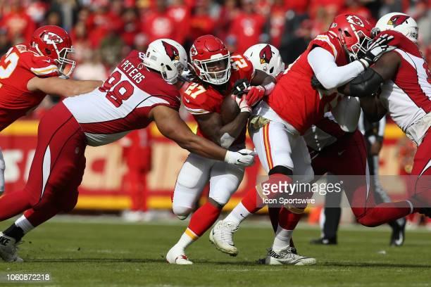 Arizona Cardinals defensive tackle Corey Peters tries to bring down Kansas City Chiefs running back Kareem Hunt during a week 10 NFL game between the...