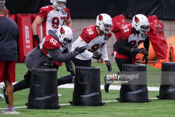 Arizona Cardinals defensive tackle Terrell McClain , Arizona Cardinals defensive tackle Corey Peters and Arizona Cardinals defensive tackle Darius...