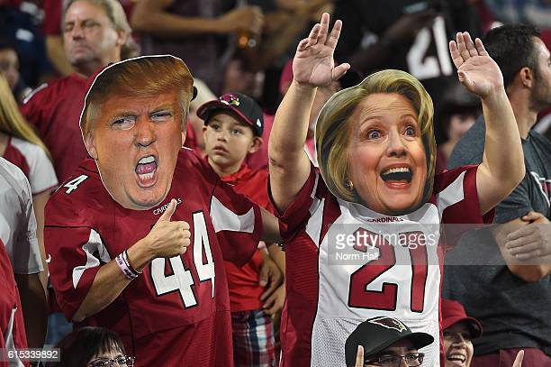 Arizona Cardinals fans wear masks of Presidential candidates Donald Trump and Hillary Clinton during the NFL game between the New York Jets and...