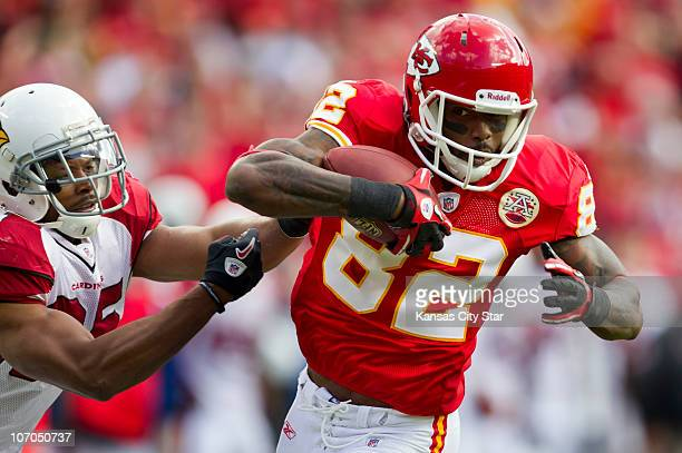Arizona Cardinals free safety Kerry Rhodes tackles Kansas City Chiefs wide receiver Dwayne Bowe after a pass reception to the oneyard line during the...