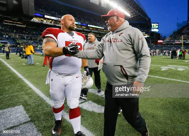 Arizona Cardinals head coach Bruce Arians greets AQ Shipley after their win over the Seattle Seahawks at CenturyLink Field on December 31 2017 in...