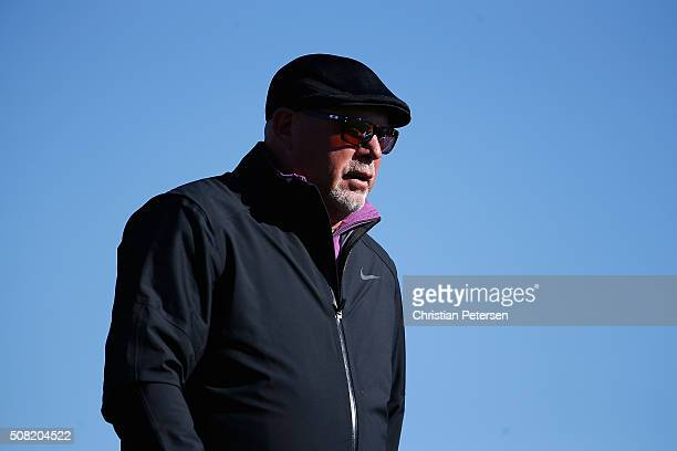 Arizona Cardinals head coach Bruce Arians watches his tee shot on the second hole during the proam for the the Waste Management Phoenix Open at TPC...