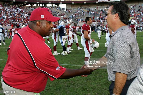 Arizona Cardinals head coach Dennis Green and Titans head coach Jeff Fisher shake hands after a game against the Tennessee Titans at Sun Devil...