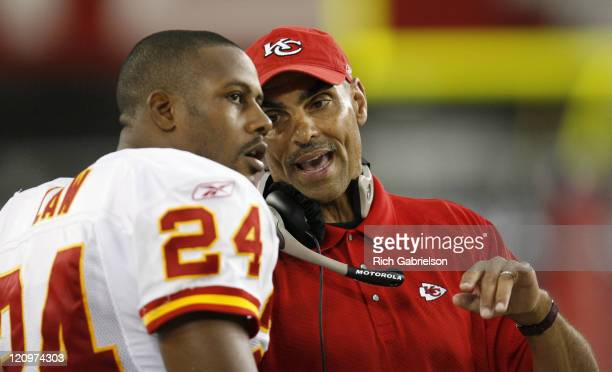 Arizona Cardinals head coach Herm Edwards with cornerback Ty Law on the sidelines The Kansas City Chiefs defeated the Arizona Cardinals by a score of...