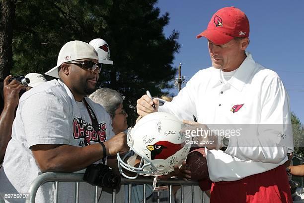 Arizona Cardinals head coach Ken Whisenhunt signs autographs during training camp on August 7 2009 in Flagstaff Arizona