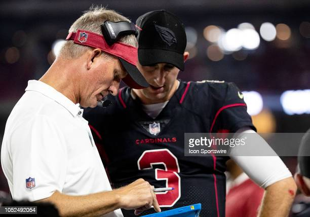Arizona Cardinals Offensive Coordinate Mike McCoy talks with his quarterback during NFL football game between the Arizona Cardinals and the Denver...