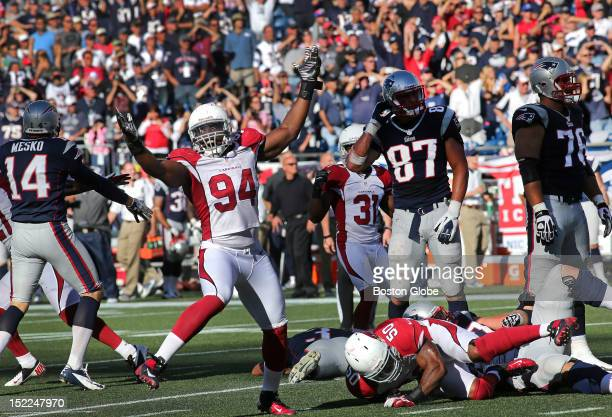 Arizona Cardinals outside linebacker Sam Acho celebrates over a prostrate New England Patriots kicker Stephen Gostkowski who missed a potential game...