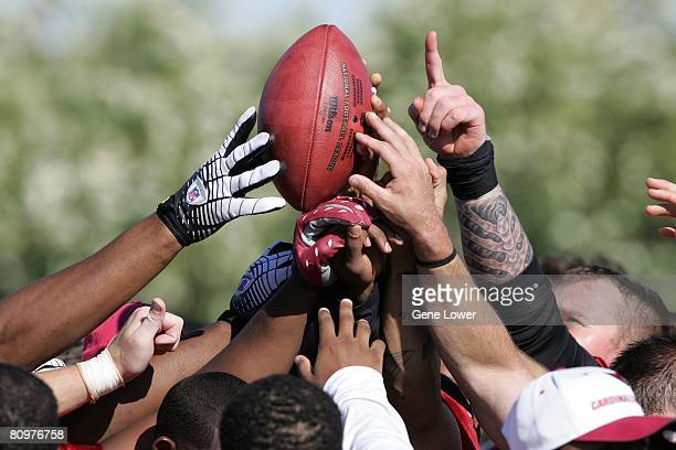 Arizona Cardinals players huddle after the first mini camp practice on May 2 2008 at the Cardinals training facility in Tempe Arizona