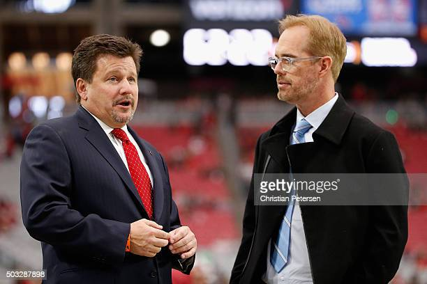 Arizona Cardinals president Michael Bidwill talks with Fox commentator Joe Buck prior to the NFL game between the Seattle Seahawks and Arizona...