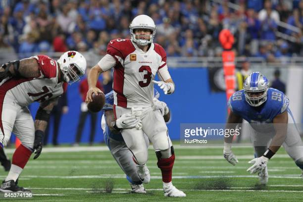 Arizona Cardinals quarterback Carson Palmer prepares to pass during the second half of an NFL football game against the Arizona Cardinals in Detroit...