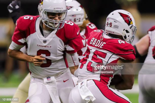Arizona Cardinals quarterback Chad Kanoff hands the ball off to running back Sherman Badie in an NFL preseason football game between the New Orleans...