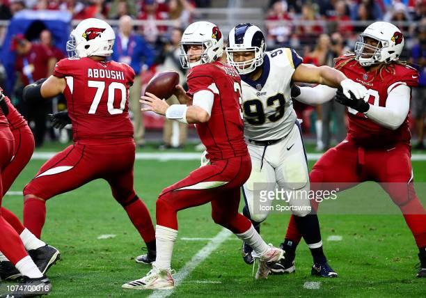 Arizona Cardinals quarterback Josh Rosen is pressured during the NFL football game between the Arizona Cardinals and the Los Angeles Rams on December...