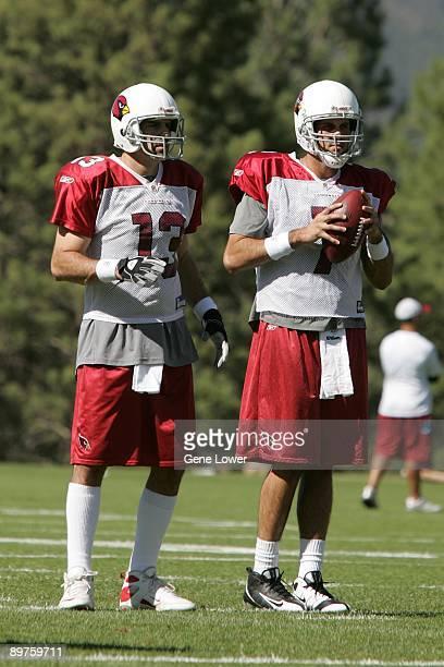 Arizona Cardinals quarterback Kurt Warner and Matt Leinart talk during training camp on August 7 2009 in Flagstaff Arizona