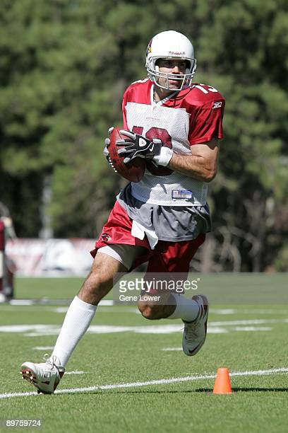 Arizona Cardinals quarterback Kurt Warner scrambles during training camp on August 7 2009 in Flagstaff Arizona