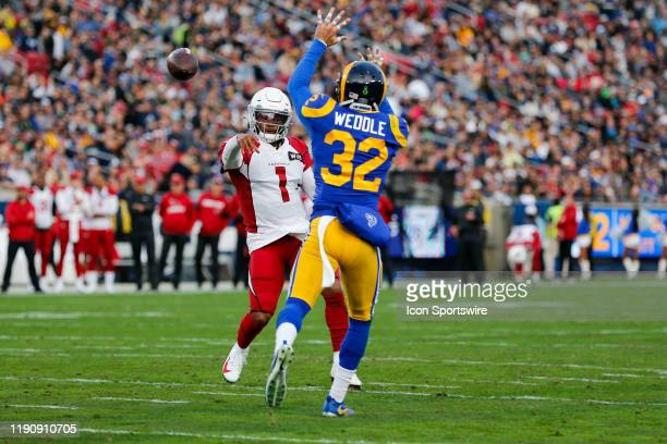 Arizona Cardinals quarterback Kyler Murray looks to throw the ball as Los Angeles Rams free safety Eric Weddle tries to block the pass during an NFL...