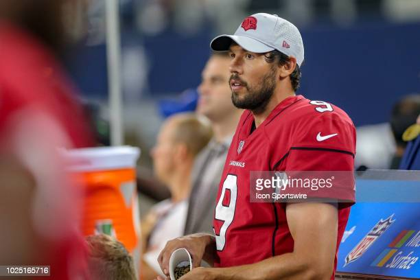 Arizona Cardinals quarterback Sam Bradford eats sunflower seeds on the sideline during the preseason football game between the Dallas Cowboys and...