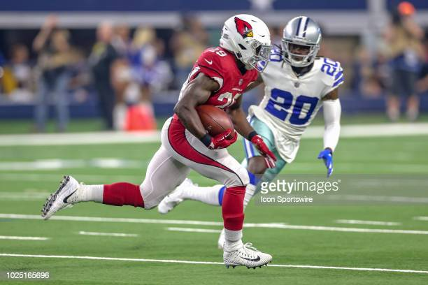 Arizona Cardinals running back Chase Edmonds is pursued by Dallas Cowboys defensive back Marqueston Huff during the preseason football game between...
