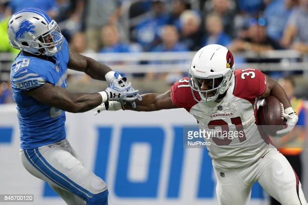 Arizona Cardinals running back David Johnson runs the ball during the second half of an NFL football game against the Detroit Lions in Detroit...