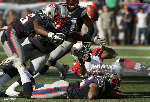 Arizona Cardinals running back Ryan Williams fumbles the ball, which was recovered by New England Patriots defensive tackle Vince Wilfork on a key...