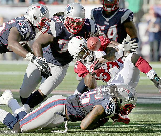 Arizona Cardinals running back Ryan Williams fumbles the ball which was recovered by New England Patriots defensive tackle Vince Wilfork on a key...