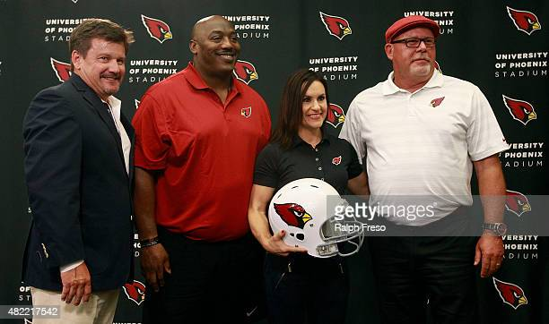 Arizona Cardinals team president Micheal Bidwill and head coach Bruce Arians stand with Levon Kirkland and Jen Welter after they where introduced as...