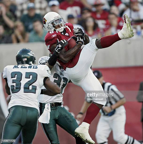Arizona Cardinals wide receiver Anquan Boldin hauls in a touchdown pass over Philadelphia Eagles defenders Donald Strickland and MIchael Lewis...