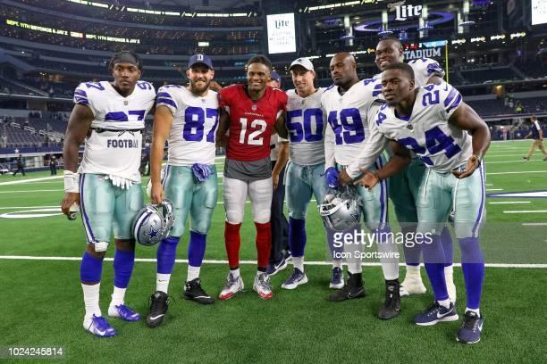 Arizona Cardinals wide receiver Brice Butler poses with former Dallas Cowboys teammates after the preseason football game between the Dallas Cowboys...