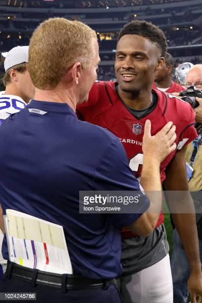 Arizona Cardinals wide receiver Brice Butler talks with Dallas Cowboys head coach Jason Garrett after the preseason football game between the Dallas...