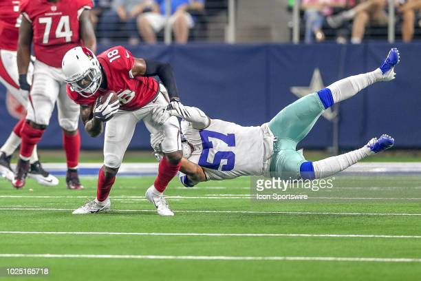 Arizona Cardinals wide receiver Greg Little tries to break free of a tackle by Dallas Cowboys linebacker Damien Wilson during the preseason football...