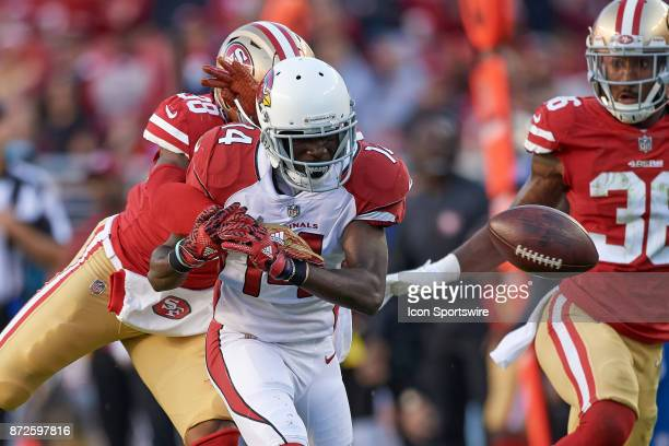 Arizona Cardinals wide receiver JJ Nelson battles with San Francisco 49ers defensive back Adrian Colbert for a pass during an NFL game between the...