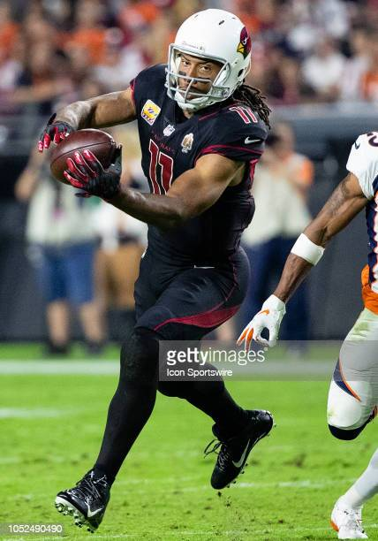 Arizona Cardinals wide receiver Larry Fitzgerald catches a pass during NFL football game between the Arizona Cardinals and the Denver Broncos on...