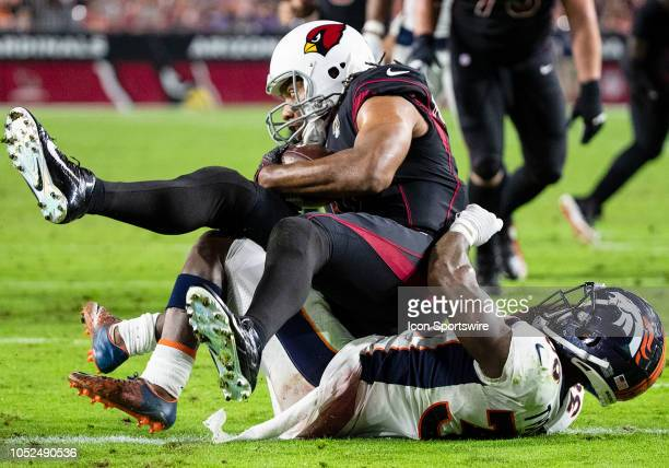 Arizona Cardinals wide receiver Larry Fitzgerald catches a touchdown pass in traffic during NFL football game between the Arizona Cardinals and the...