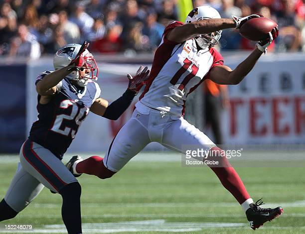 Arizona Cardinals wide receiver Larry Fitzgerald pulls in a pass reception but the play was called back due to a penalty on the Arizona Cardinals as...