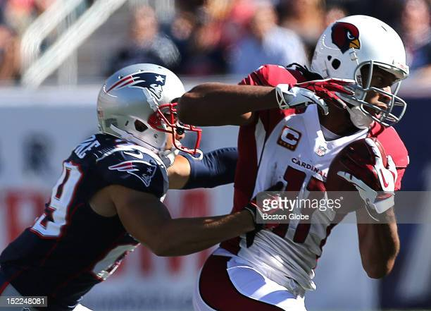 Arizona Cardinals wide receiver Larry Fitzgerald pulls in a pass reception, but the play was called back due to a penalty on the Arizona Cardinals as...