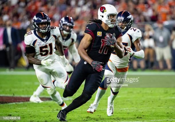 Arizona Cardinals wide receiver Larry Fitzgerald runs the ball upfield during NFL football game between the Arizona Cardinals and the Denver Broncos...