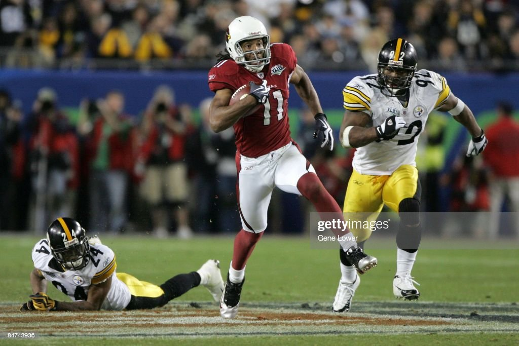 Arizona Cardinals wide receiver Larry Fitzgerald #11 scores a 64 yard touchdown against the Pittsburgh Steelers during Super Bowl XLIII on February 1, 2009 at Raymond James Stadium in Tampa, Florida. The Steelers won the game 27-23.