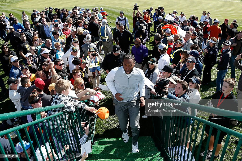 Arizona Cardinals wide receiver Larry Fitzgerald walks off the 18th green following the pro-am for the the Waste Management Phoenix Open at TPC Scottsdale on February 3, 2016 in Scottsdale, Arizona.
