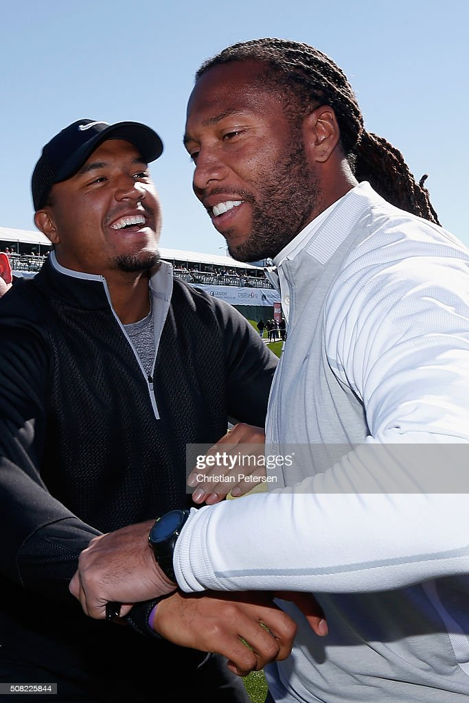 Arizona Cardinals wide receivers Michael Floyd and Larry Fitzgerald joke around off the 18th green following the pro-am for the the Waste Management Phoenix Open at TPC Scottsdale on February 3, 2016 in Scottsdale, Arizona.