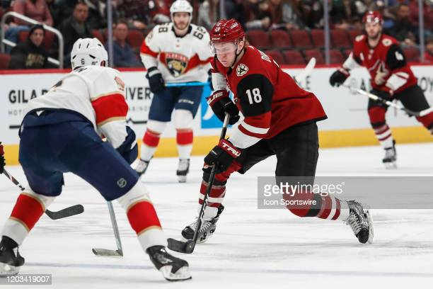 Arizona Coyotes center Christian Dvorak controls the puck during the NHL hockey game between the Florida Panthers and the Arizona Coyotes on February...