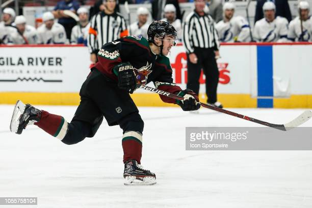 Arizona Coyotes center Clayton Keller follows through on a shot during the NHL hockey game between the Tampa Bay Lightning and the Arizona Coyotes on...
