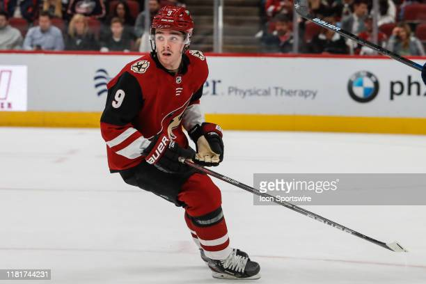 Arizona Coyotes center Clayton Keller looks for the puck during the NHL hockey game between the Columbus Blue Jackets and the Arizona Coyotes on...