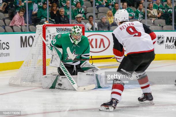 Arizona Coyotes center Clayton Keller shots the puck toward Dallas Stars goaltender Ben Bishop during the game between the Dallas Stars and the...