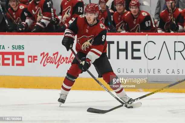 Arizona Coyotes center Clayton Keller skates with the puck during the NHL hockey game between the Columbus Blue Jackets and the Arizona Coyotes on...