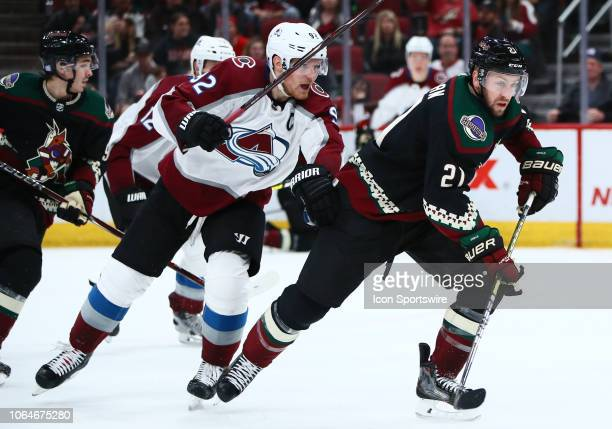 Arizona Coyotes center Derek Stepan battles for the puck during the NHL hockey game between the Arizona Coyotes and the Colorado Avalanche on...